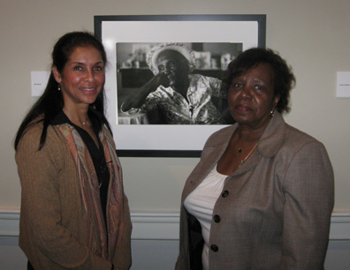 Photographer Jeanne Moutoussamy-Ashe and Elnora M. Brown, the granddaughter of Miss Bertha, pictured in the background.