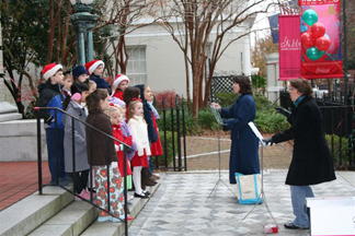 Mt. Pleasant Presbyterian Children's Choir caroling on the museum steps