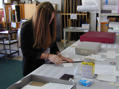Laura Reece measuring archival board