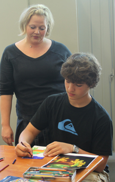Anne Cimballa working with a student