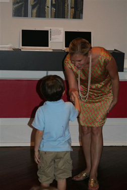 Eli Barker receiving his certificate from Mrs. Lizz