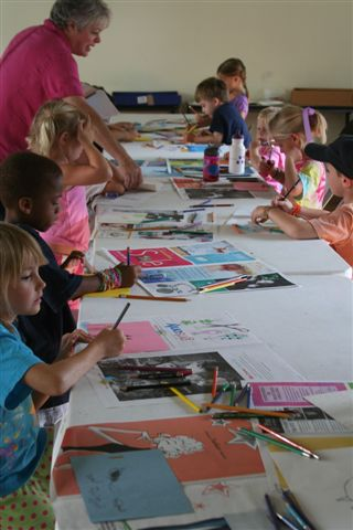 Sally Collins, art educator, works with campers to create their own works of art.