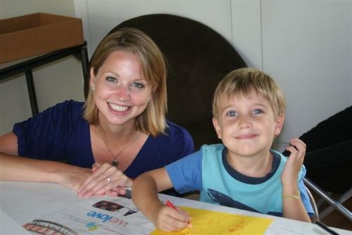 Katie Gephart, summer intern, working with camper Parker Weeks.