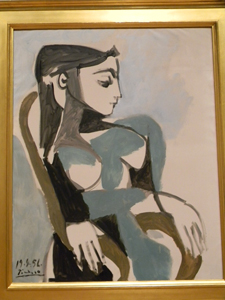 <em>Femme dans un fauteuil</em>, 1956, by Pablo Picasso (Spanish, 1881 – 1973). Oil on canvas; 39 ½ x 31 ½ in. Courtesy of Esther and James Ferguson.