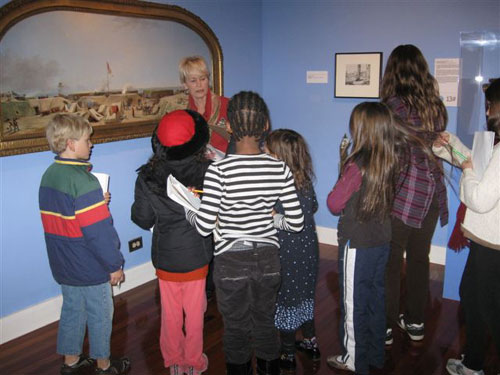 Museum Educator Elise Detterbeck and students in the galleries.