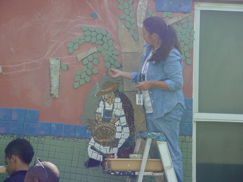 Annie Purvis at work on a mosaic mural