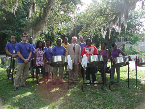Charleston Mayor Joseph Riley with steel drum band at the Rural Murals unveiling ceremony.