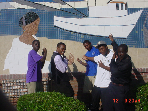 Students show off the mosaic mural at Lincoln Middle-High School.
