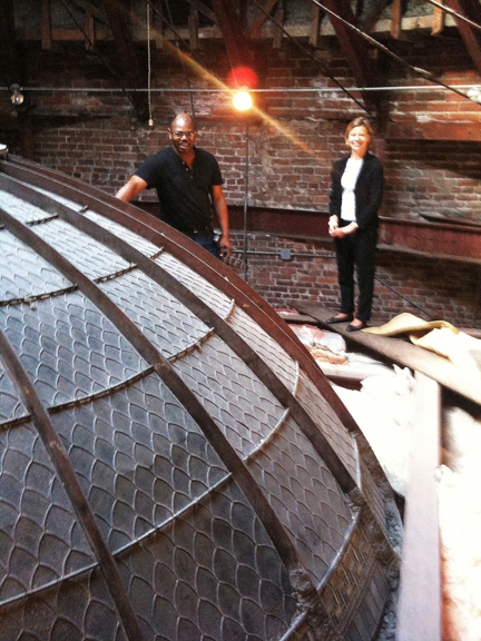 Greg Jenkins and Anita Jorgensen examine the dome structure from above the Rotunda Gallery.