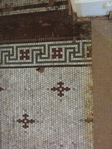 A detail of the tile design in the flooring original to the Beaux-Arts building.
