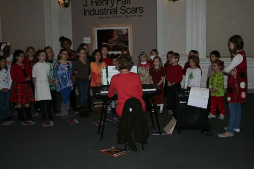 A choir from Blessed Sacrament School sings carols in the Rotunda gallery.