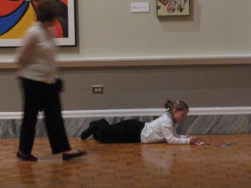 A young artist at work in the galleries.