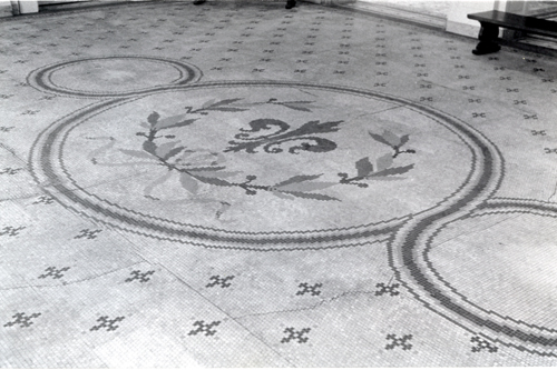 The roundel pattern in the tessera tile floor of the Rotunda gallery.