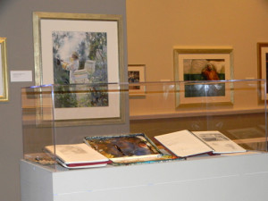A gallery view of Whyte's tools and sketchbooks on display in Mary Whyte: Working South.