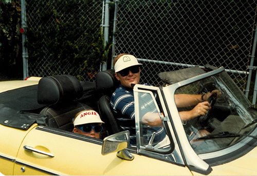 My sister Angie and my dad in his MG, 1981.