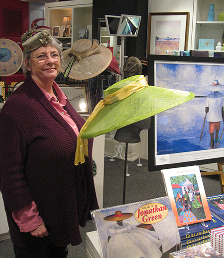 Meyriel surrounded by her designs in the Gibbes Museum Store.