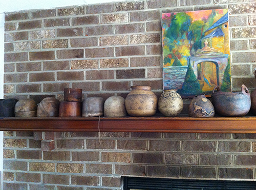 Meyriel's pots and blocks displayed together on her mantel.
