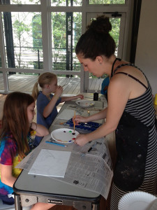 Camp Instructor, Kristen Solecki, talks with campers about color palettes.