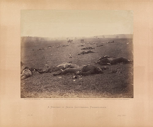 Timothy H. O'Sullivan (American, born Ireland, 1840–1882), Alexander Gardner (American, Glasgow, Scotland 1821–1882 Washington, D.C.), A Harvest of Death, Gettysburg, Pennsylvania, July 1863; albumen silver print from glass negative, accompanied by text page from Gardner's Sketchbook; The Metropolitan Museum of Art