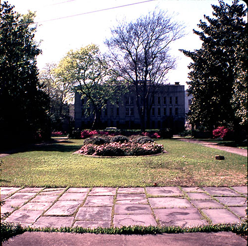 A view of the courtyard, ca. 1960s, with the Charleston Library Society in the distance.