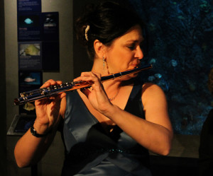 CMC flutist Regina Helcher Yost (playing at the SC Aquarium).  Photo courtesy of  BT Hunter Photography