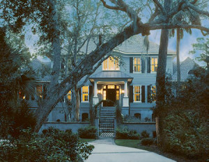 This transitional style home on a quiet cul-de-sac is entered through a tranquil courtyard filled with majestic oaks, camellias, and confederate jasmine reminiscent of downtown Charleston gardens.