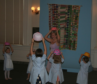 Once Upon a Ballet teacher Rachel Epps leads young dancers during a performance in the Rotunda