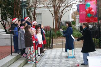 Mt. Pleasant Presbyterian Children's Choir caroling on the museum steps