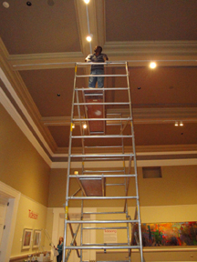 Facility Manager/Preparator Greg Jenkins setting lights in the Main Gallery