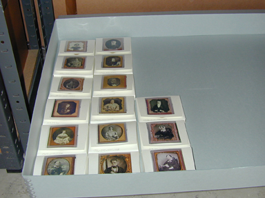 Cased photographs in their new storage container