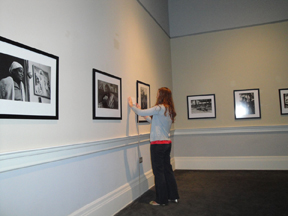 Laura Reece hanging labels in the Daufuskie Island exhibition