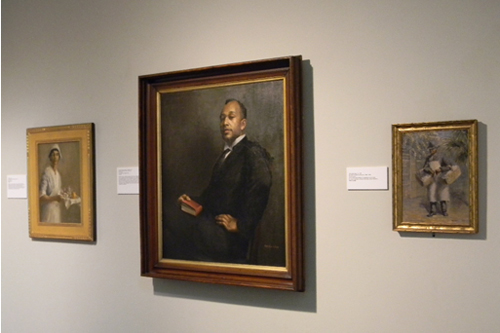 Gallery Installation View (left to right): The Nurse, 1917; Portrait of Reverend Caesar S. Ledbetter, 1921; and The Honey Man, ca. 1929, all by Edwin Harleston (American, 1882 – 1931).