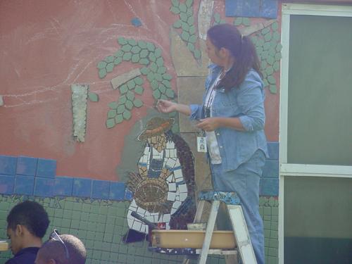 Annie Purvis at work on a mosaic mural
