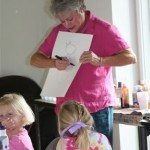 Sally Collins demonstrates a drawing technique with the campers.