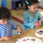 Campers create artist palettes.