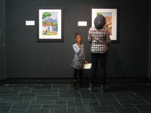 A family explores the galleries together.