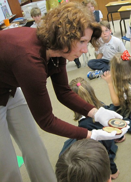 Showing the class a 19th century miniature portrait painted with water color on ivory