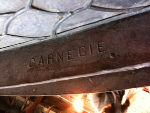 Carnegie stamped the steel ribs used to support the stained-glass panels of the dome.