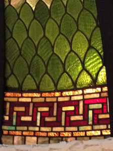 A detail of the intricate patern of cut stained glass.