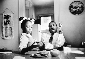 Dr. Martin Luther King, Jr., with his daughter, Yolanda, by James Karales