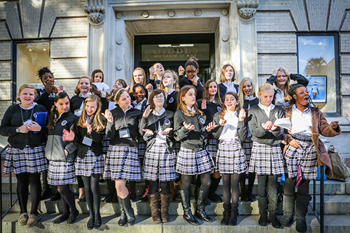 The 7th-grade girls pose in front of the Gibbes before their special tours.