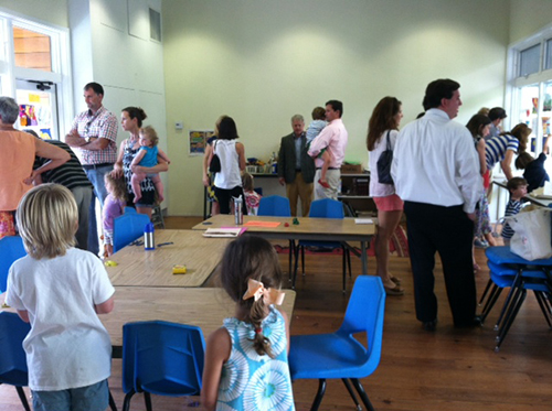 Parents and campers enjoy an art show at week's end.
