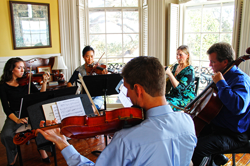 CMC performs a house concert at The Palmer House on the Battery.