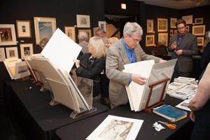 Guests at the First Look Celebration perused the works of art for sale.
