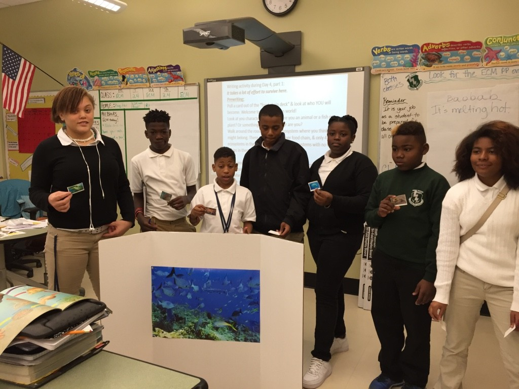 Acting out a food chain in the marine biome.