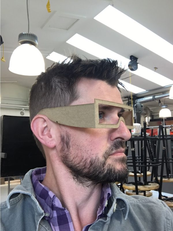 Artist Michael Zebrowski models a prototype of the Observer eclipse viewing glasses.