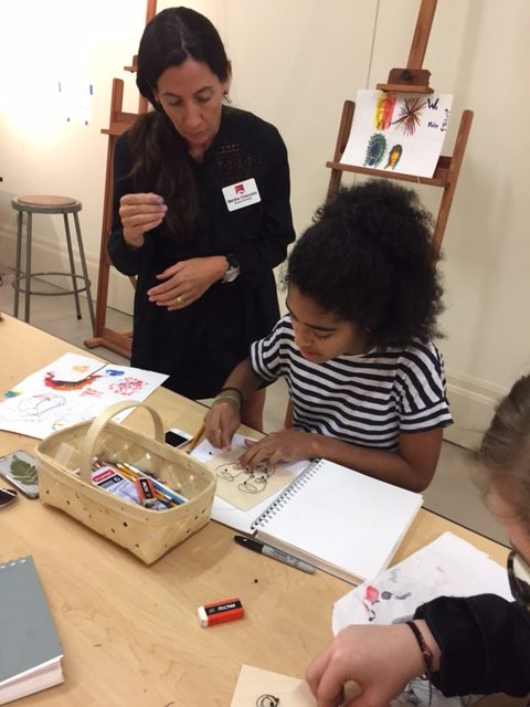 Teaching artist Martha Criscuolo works with campers.