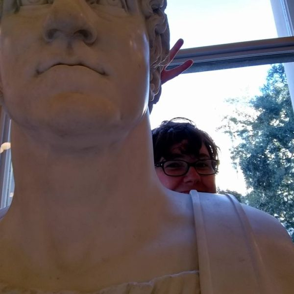 """Becca is spotted """"photo-bombing"""" a sculpture in the rotunda."""