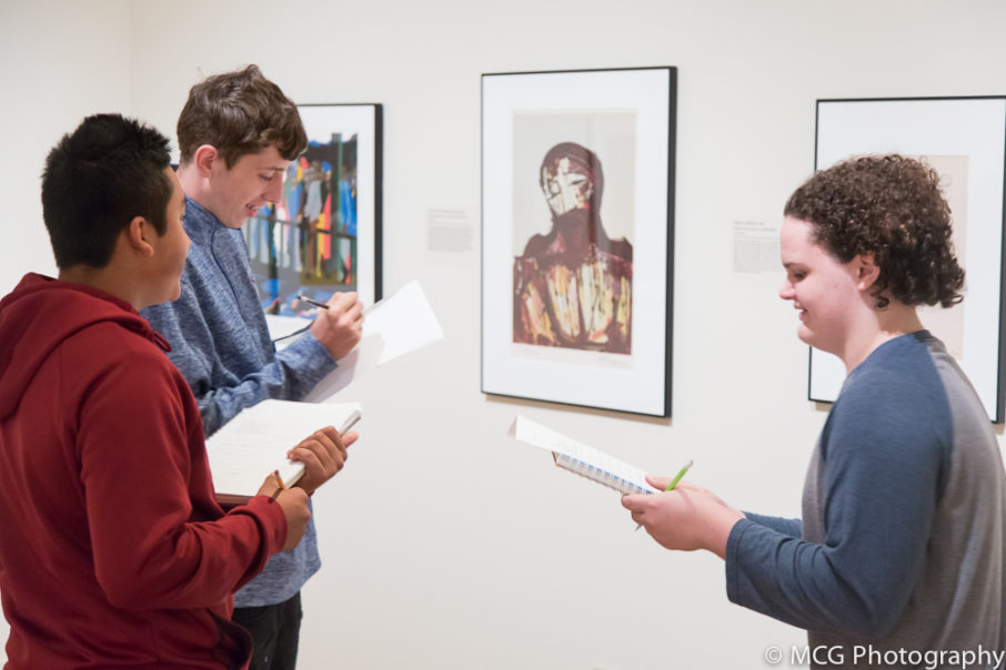Students engage with artwork during an in-gallery activity