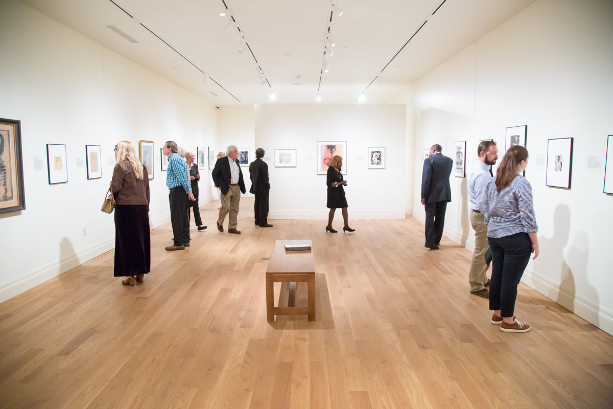Museum patrons enjoying a recent exhibition at the Gibbes.